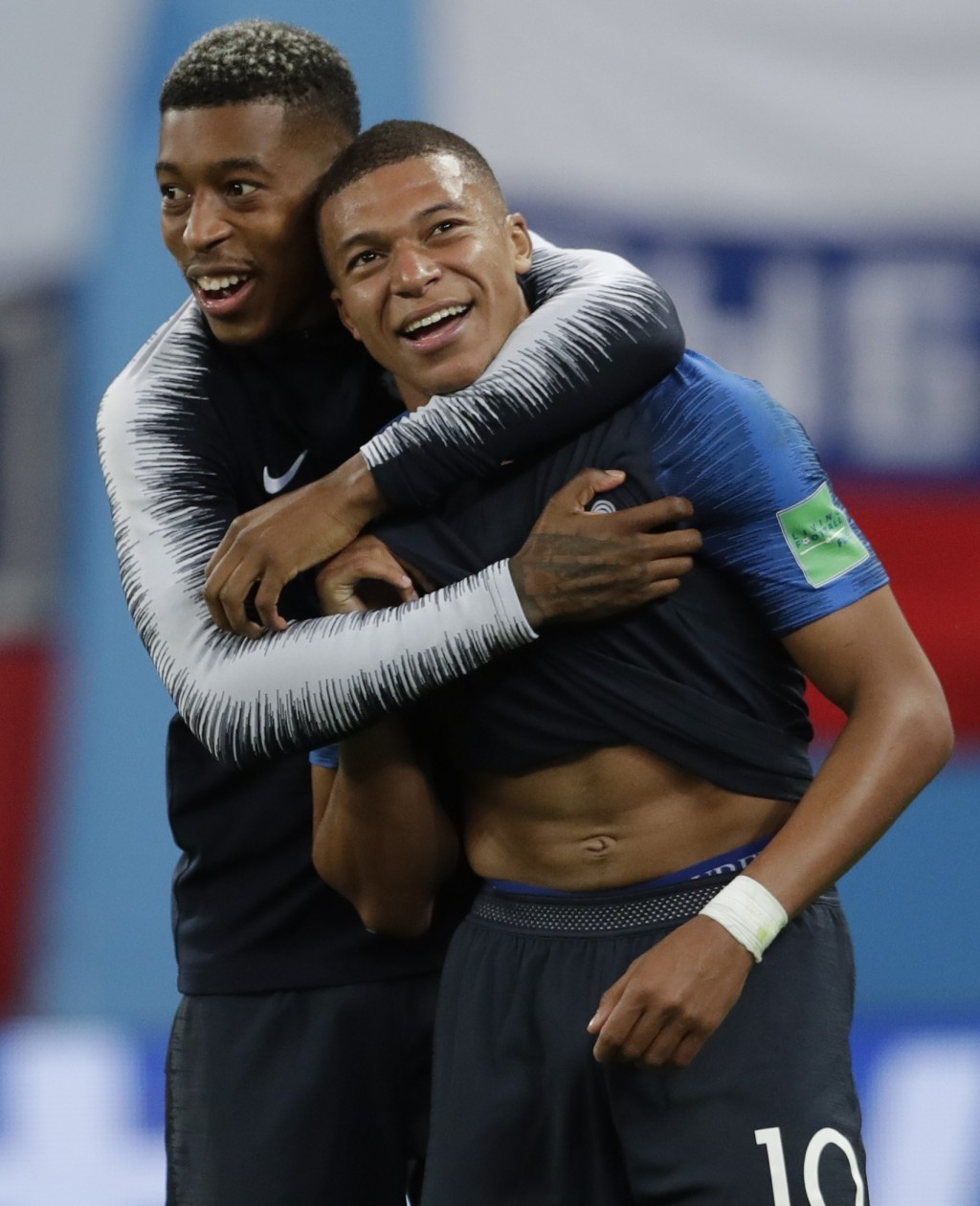 France's Kylian Mbappe, right, and Presnel Kimpembe celebrate at the end of the semifinal match between France and Belgium at the 2018 soccer World Cu