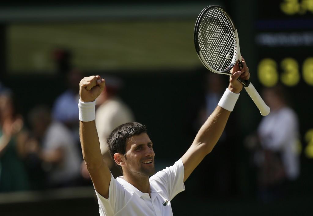Novak Djokovic of Serbia celebrates defeating Kei Nishikori of Japan during their men's quarterfinal match at the Wimbledon Tennis Championships in Lo
