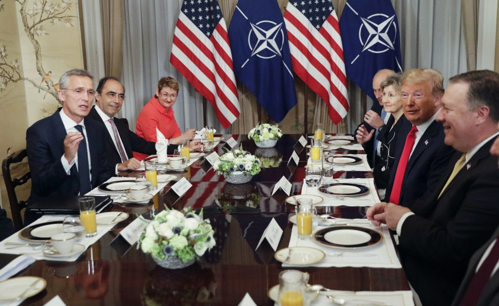 U.S. President Donald Trump, second right, listens to NATO Secretary General Jens Stoltenberg, left, during their bilateral breakfast, Wednesday July