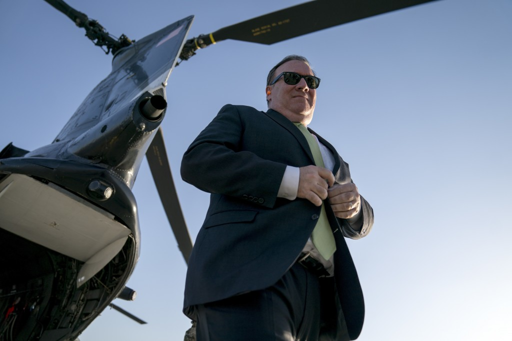 FILE - In this Monday, July 9, 2018 file photo, Secretary of State Mike Pompeo arrives at Camp Alvarado in Kabul, Afghanistan after meeting with Afgha...