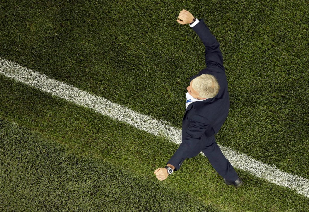 France head coach Didier Deschamps celebrates after the the semifinal match between France and Belgium at the 2018 soccer World Cup in the St. Petersb
