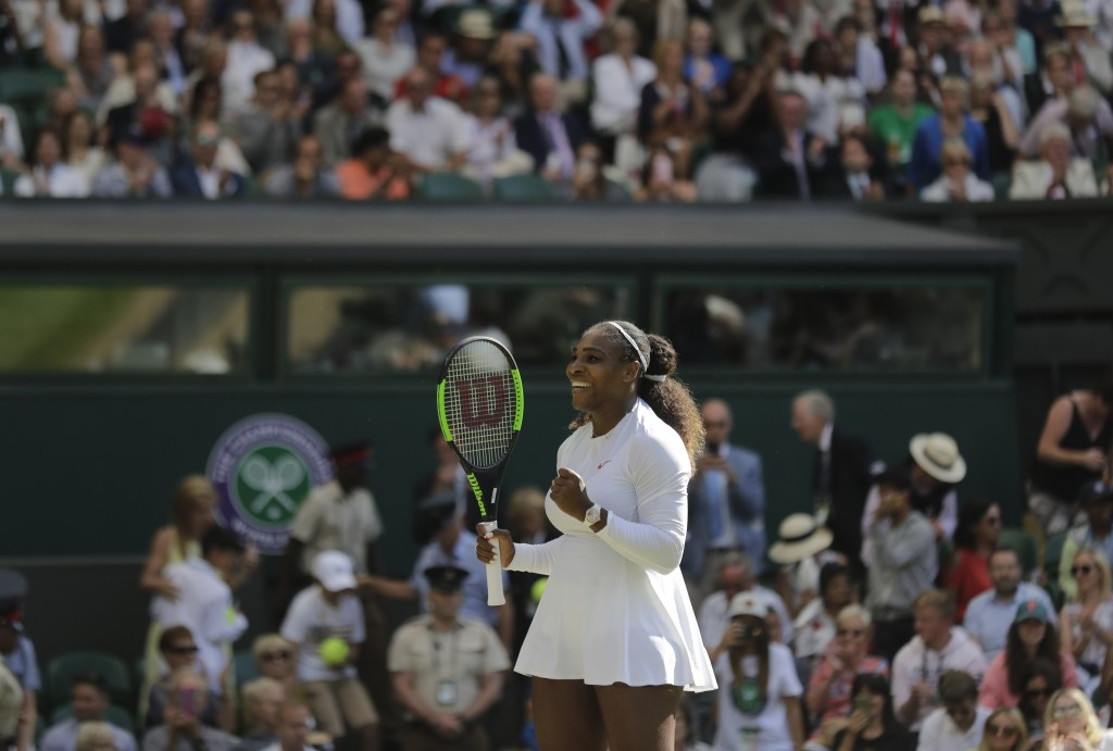 Serena Williams of the United States celebrates winning her women's singles quarterfinals match against Italy's Camila Giorgi, at the Wimbledon Tennis