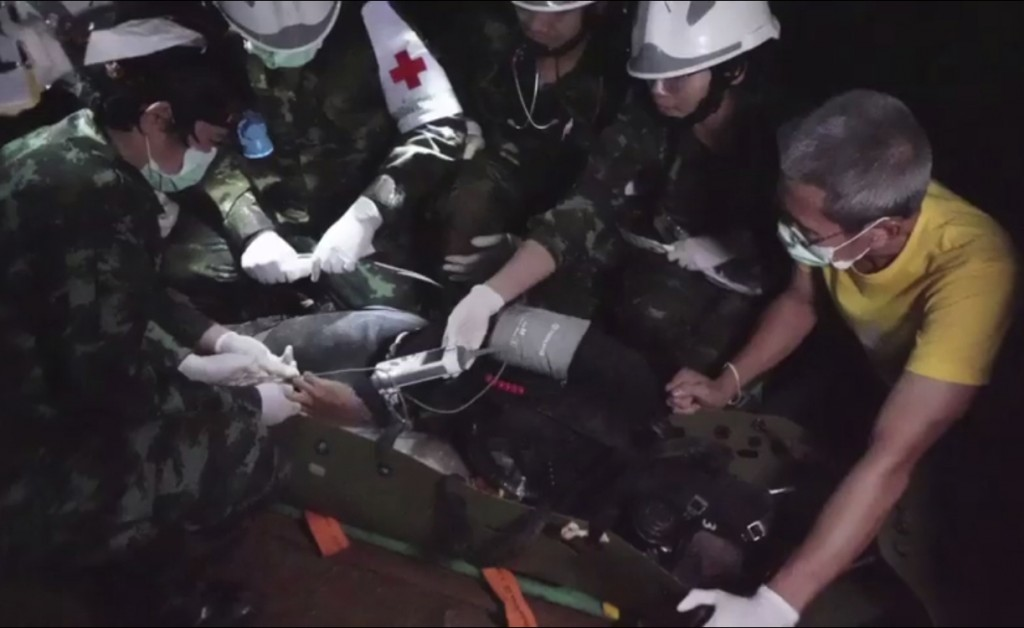 This undated photo from video released via the Thai NavySEAL Facebook Page on Wednesday, July 11, 2018, shows rescuers hold an evacuated boy inside th