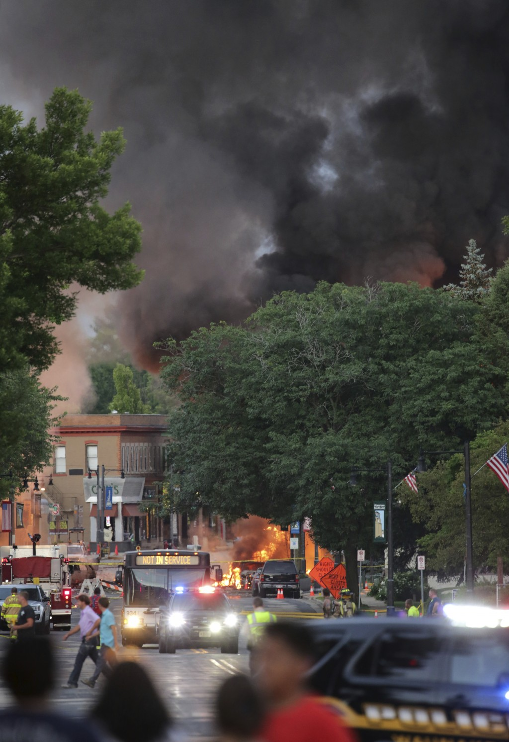 Smoke rises as firefighters work the scene of an explosion in downtown Sun Prairie, Wis., Tuesday, July 10, 2018. The explosion rocked the downtown ar