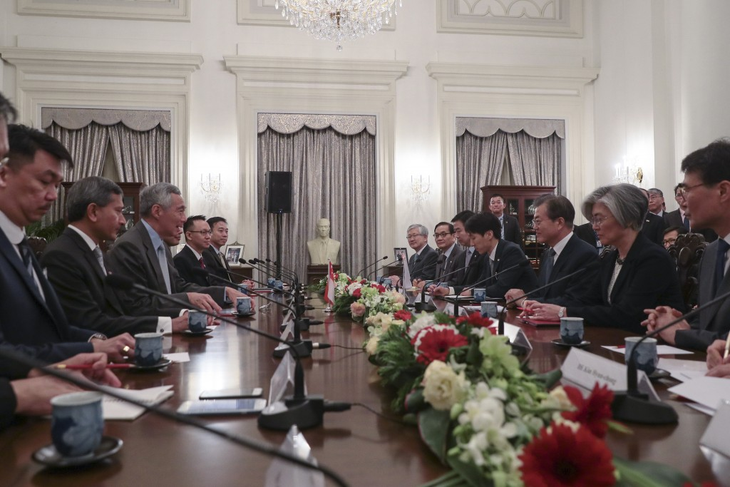 Singapore Prime Minister Lee Hsien Loong, third from left, and South Korea President Moon Jae-in, third from right, attend a meeting with their respec