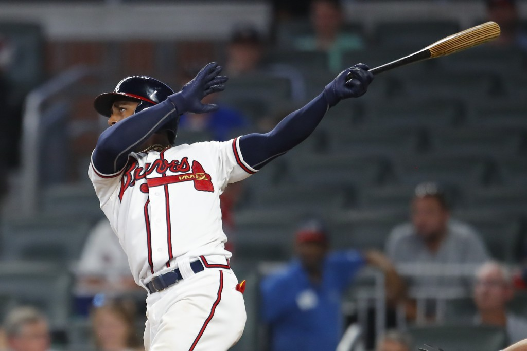 Atlanta Braves' Ozzie Albies watches his two-run home run in the eighth inning of a baseball game against the Toronto Blue Jays, Wednesday, July 11, 2