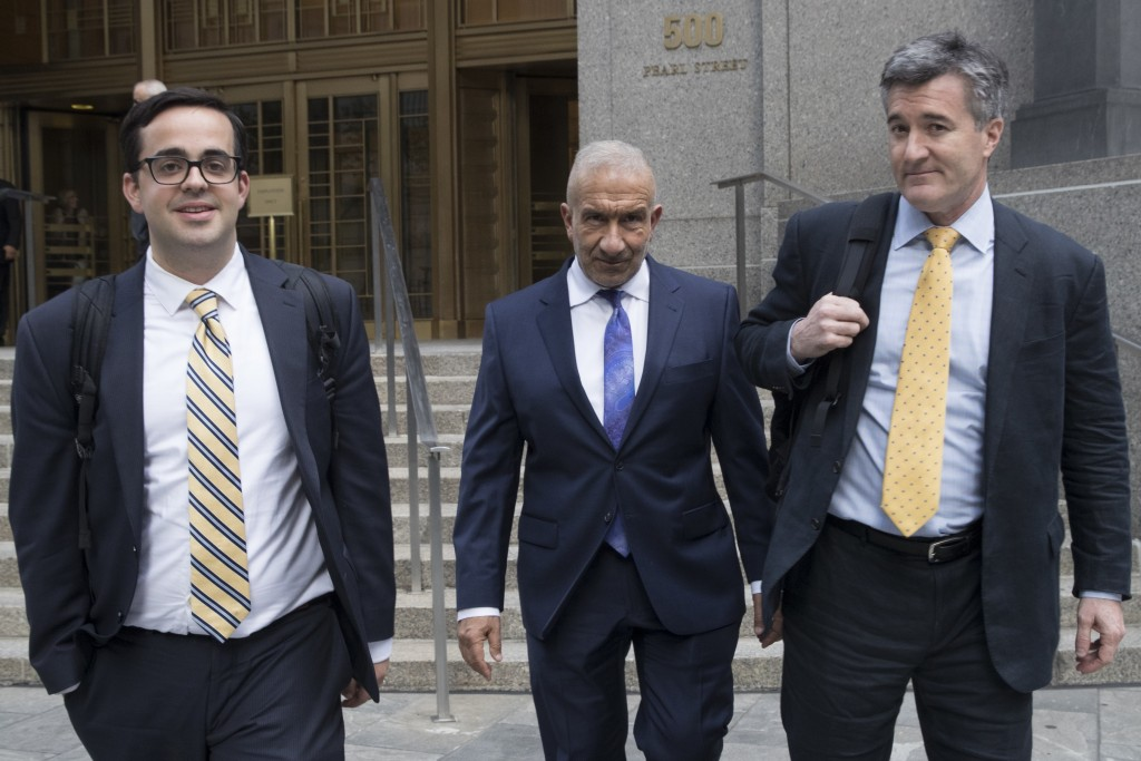 Alain Kaloyeros, center, a former president of the State University of New York's Polytechnic Institute, leaves Federal court where he is on trial on