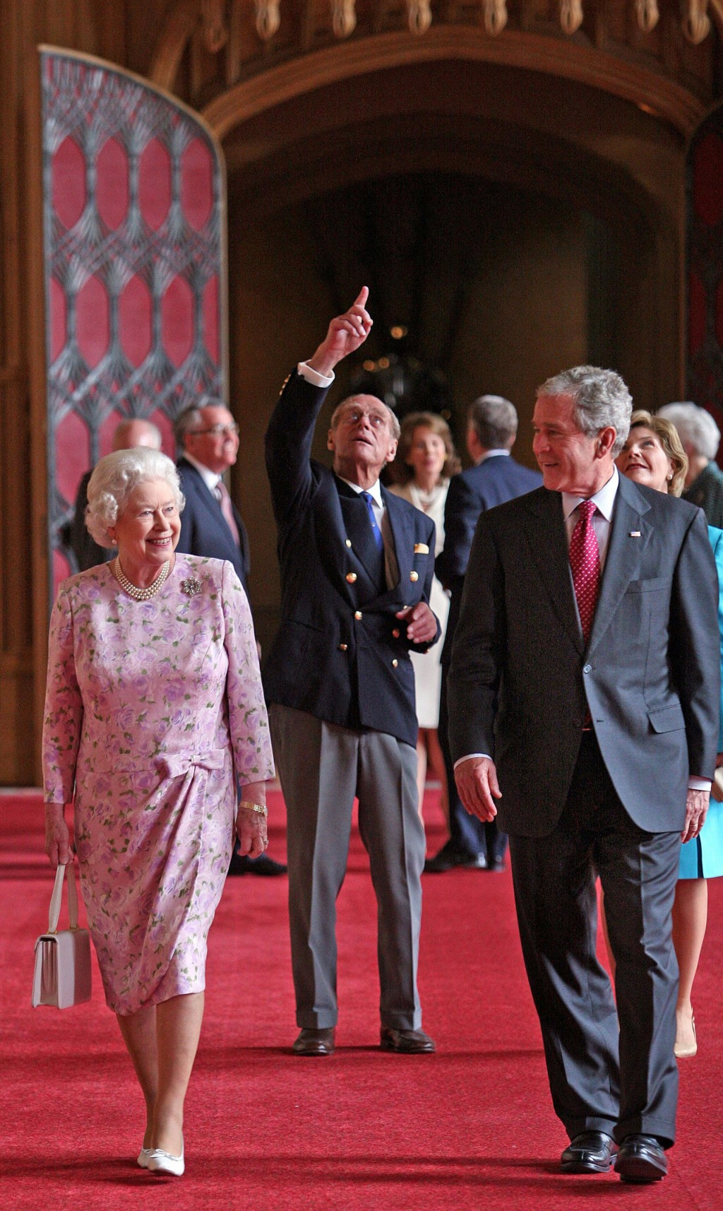 FILE  - In this Sunday, June 15, 2008 file photo, Britain's Queen Elizabeth II and  Prince Philip, the Duke of Edinburgh, pointing, walk with US Presi