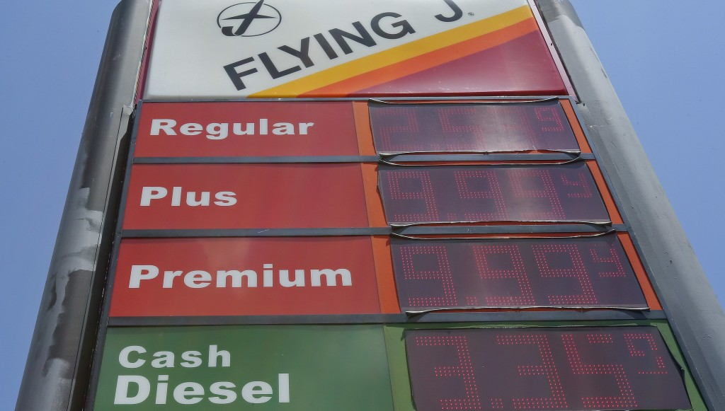 FILE- This June 14, 2018, file photo shows signage and gas prices for regular and diesel at Flying J along Interstate 85 and 40 near Graham, N.C. On T