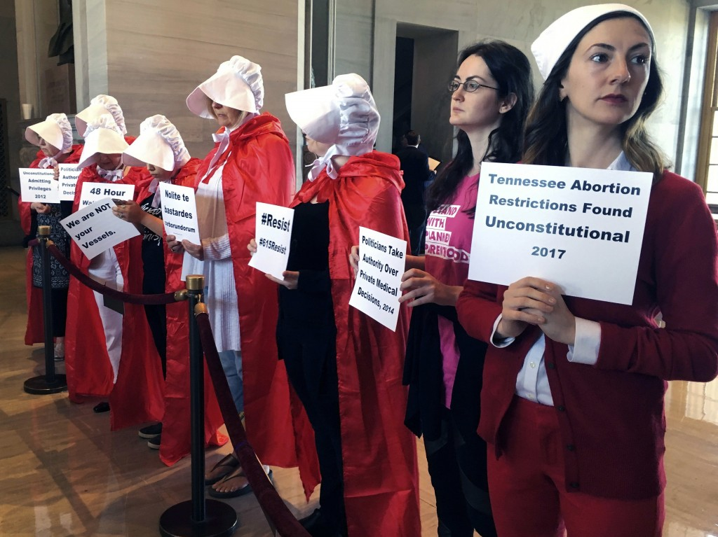 FILE - In this May 3, 2017 file photo, protesters organized by Planned Parenthood demonstrate at the state Capitol in Nashville, Tenn., to express the