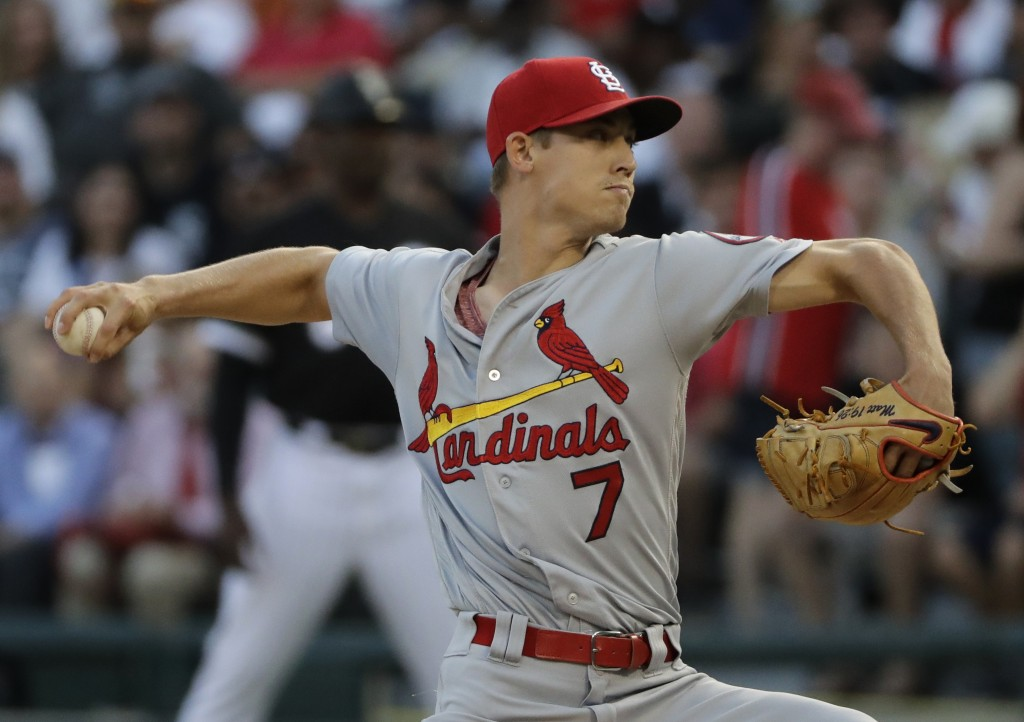 St. Louis Cardinals starting pitcher Luke Weaver throws to a Chicago White Sox batter during the first inning of a baseball game in Chicago, Wednesday