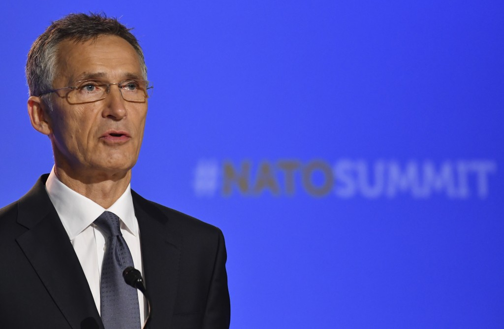 NATO Secretary-General Jens Stoltenberg speaks at a press conference during a summit of heads of state and government at NATO headquarters in Brussels