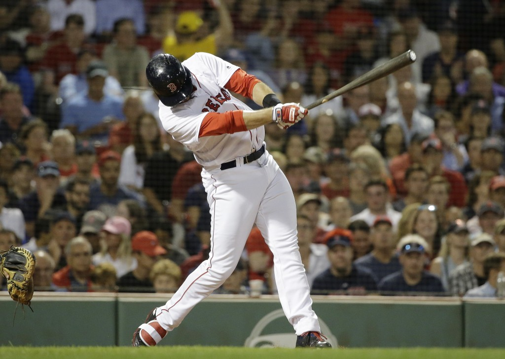 Boston Red Sox's J.D. Martinez hits a two-run double off  Texas Rangers' Bartolo Colon during the fifth inning of a baseball game, Wednesday, July 11,