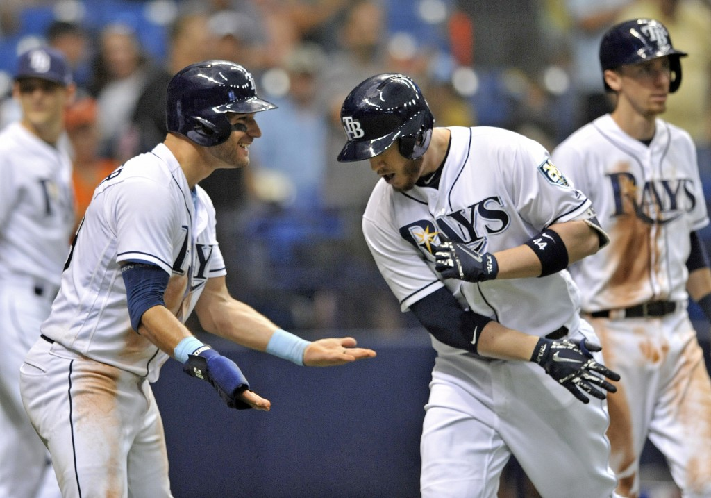 Tampa Bay Rays' Kevin Kiermaier, left, celebrates with C.J. Cron, center, after he scored with Matt Duffy, right, on Cron's three-run home run off Det