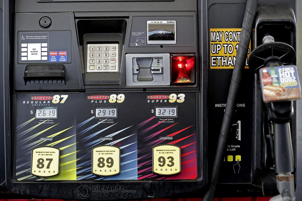 FILE- In this June 14, 2018, file photo gasoline prices are displayed on a pump at Sheetz along the Interstate 85 and 40 corridor near Burlington, N.C