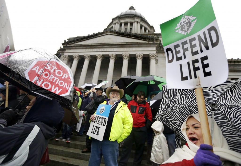 FILE - In this Jan. 19, 2016, file photo, demonstrators opposing abortion take part in a rally at the Capitol, in Olympia, Wash. If a Supreme Court ma