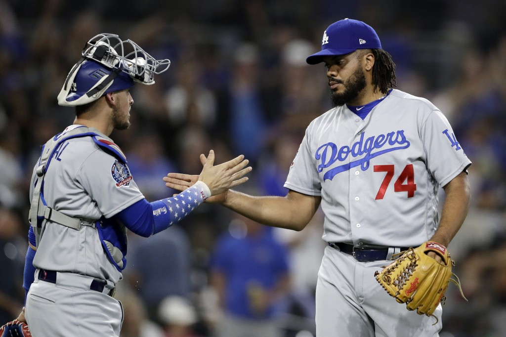 Los Angeles Dodgers relief pitcher Kenley Jansen (74) celebrates with catcher Yasmani Grandal after defeating the San Diego Padres in a baseball game