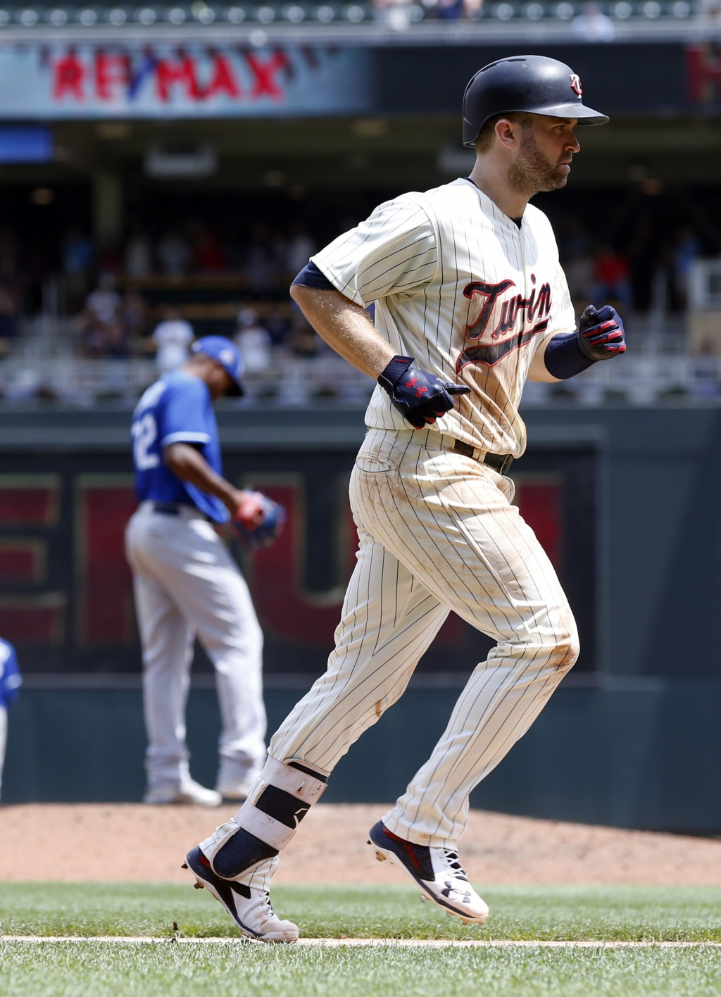 Minnesota Twins' Brian Dozier jogs home after hitting a two-run home run off Kansas City Royals reliever Enny Romero, left, in the sixth inning of a b
