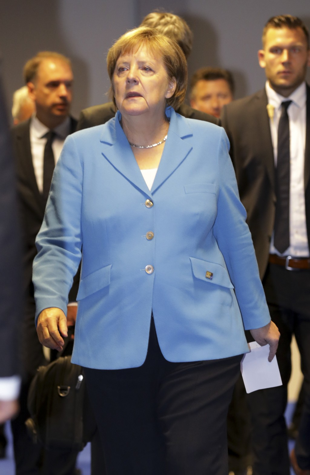 German Chancellor Angela Merkel walks during a summit of heads of state and government at NATO headquarters in Brussels, Belgium, Thursday, July 12, 2