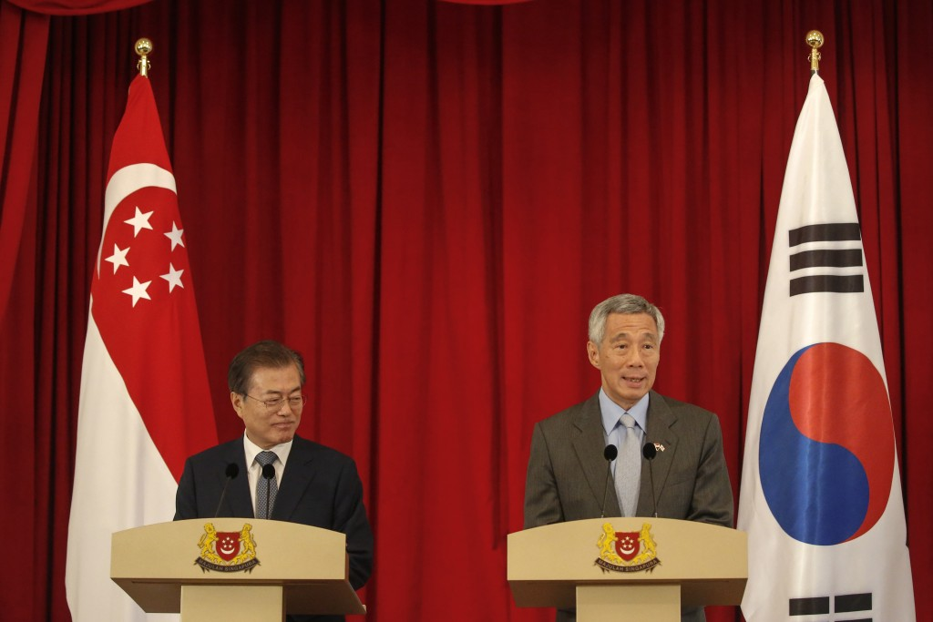 South Korea President Moon Jae-in, left, and Singapore Prime Minister Lee Hsien Loong hold a press conference at the Istana Presidential Palace in Sin