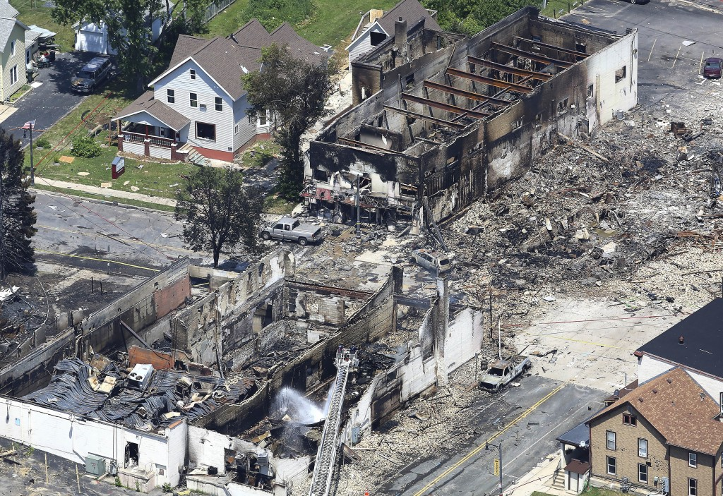 In a view looking northwest from above, the aftermath of a gas explosion in downtown Sun Prairie, Wis., is seen Wednesday, July 11, 2018. At the top r