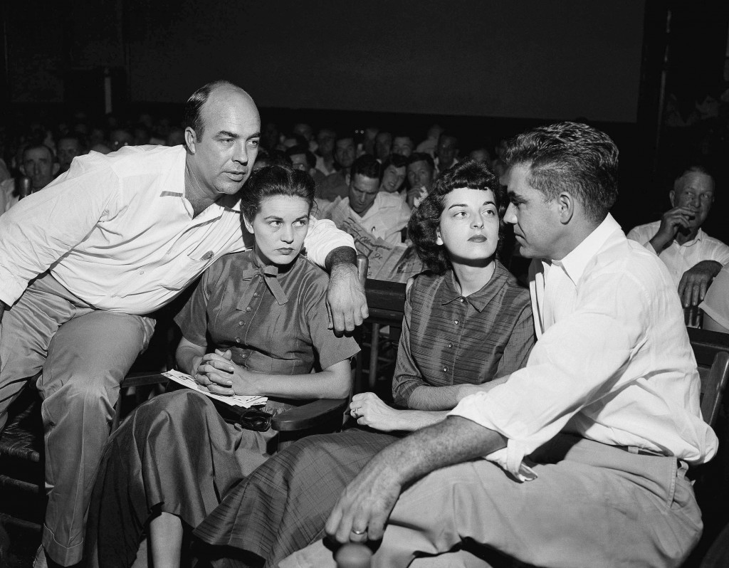 FILE - In this Sept. 23, 1955, file photo, J.W. Milam, left, his wife, second left, Roy Bryant, far right, and his wife, Carolyn Bryant, sit together