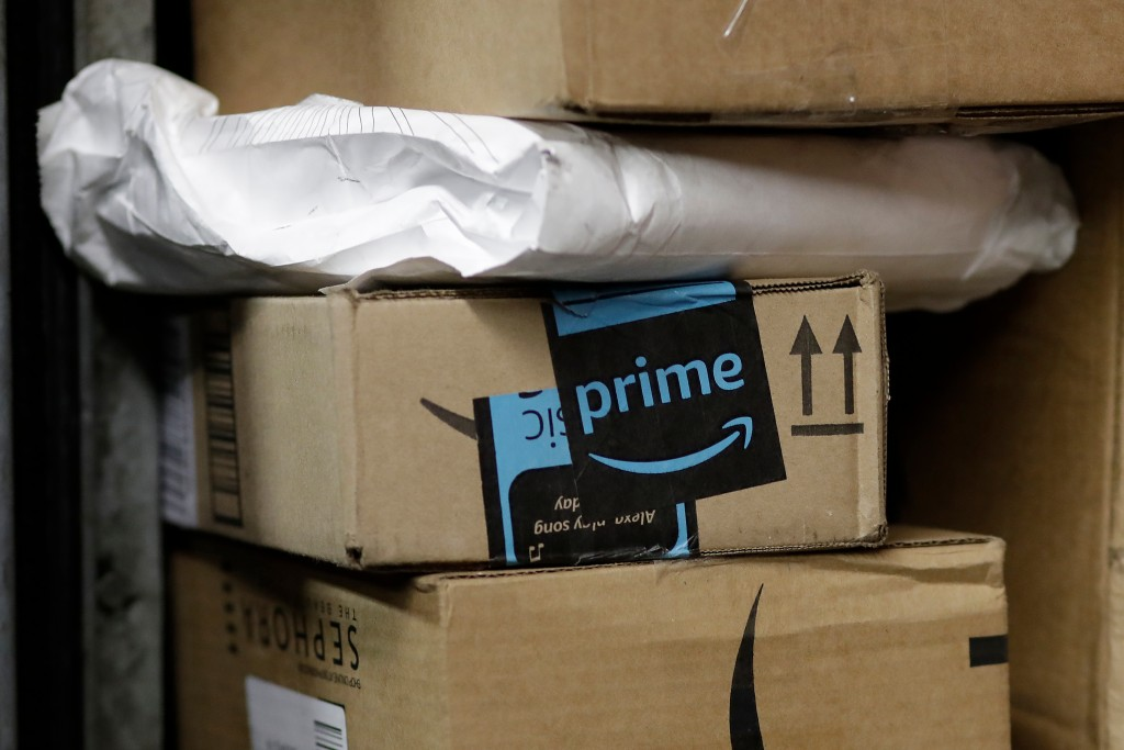 FILE- In this May 9, 2017, file photo, a package from Amazon Prime is loaded for delivery in New York.  Amazon's Prime Day starts July 16, 2018, and w