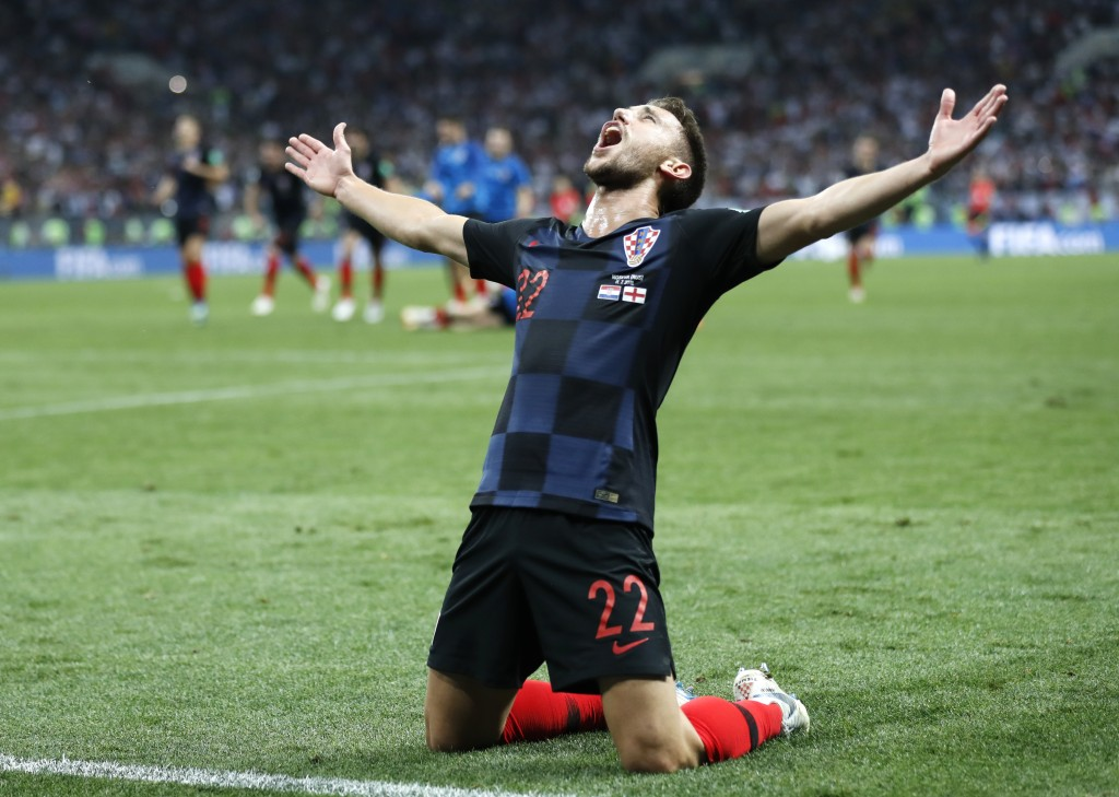Croatia's Josip Pivaric celebrates after his team advanced to the final during the semifinal match between Croatia and England at the 2018 soccer Worl