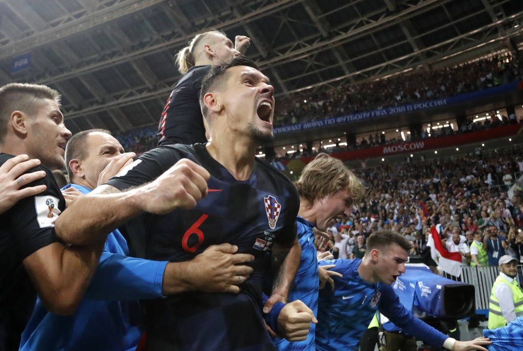Croatia's Dejan Lovren celebrates after Croatia's Mario Mandzukic scored his side's second goal during the semifinal match between Croatia and England
