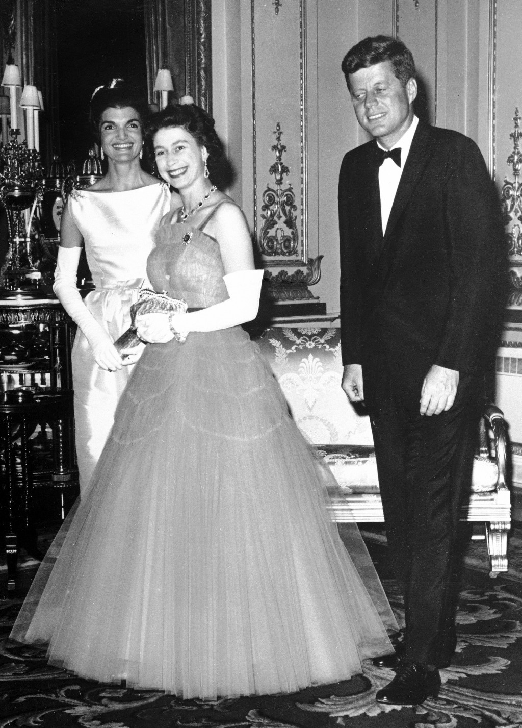 FILE - In this file photo dated June 5, 1961, Britain's Queen Elizabeth II, centre, walks with US President John F. Kennedy, right, and his wife Jacqu