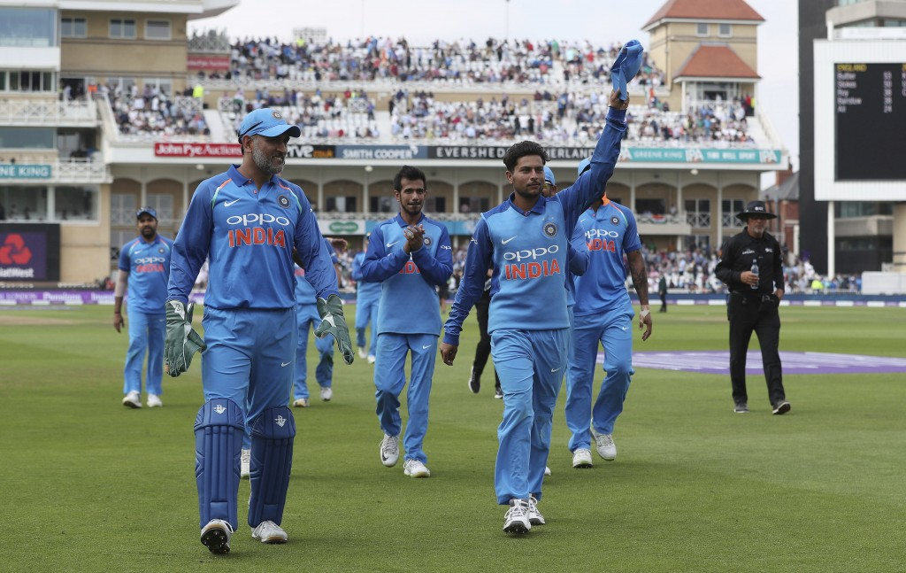 India's Kuldeep Yadav, center right, acknowledges the crowd at the end of the England innings during the One Day International Series cricket match be