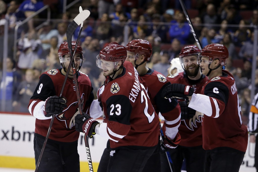 FILE - In this March 31, 2018, file photo, Arizona Coyotes defenseman Oliver Ekman-Larsson (23) celebrates with teammates after scoring in the second