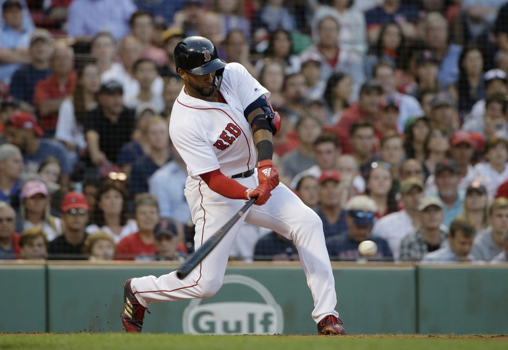 Boston Red Sox's Eduardo Nunez hits the ball off Texas Rangers' Bartolo Colon during the second inning of a baseball game Wednesday, July 11, 2018, in