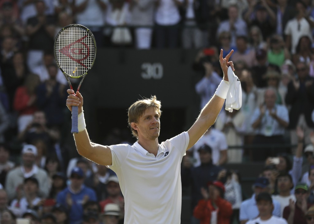 Kevin Anderson of South Africa celebrates winning his men's quarterfinals match against Switzerland's Roger Federer, at the Wimbledon Tennis Champions