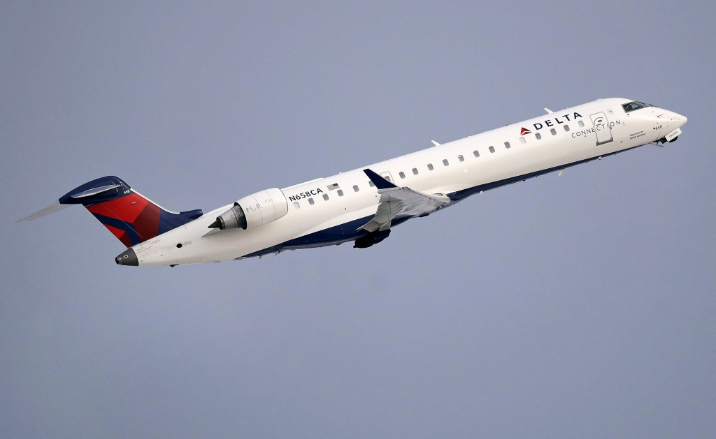 FILE- In this Jan. 8, 2018, file photo, a Delta Air Lines Connection regional jet operated by GoJet Airlines takes off from Logan International Airpor