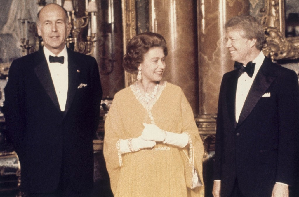 FILE - In this file photo dated  May 1977, U.S. President Jimmy Carter, right, and Britain's Queen Elizabeth II with French President Valery Giscard d
