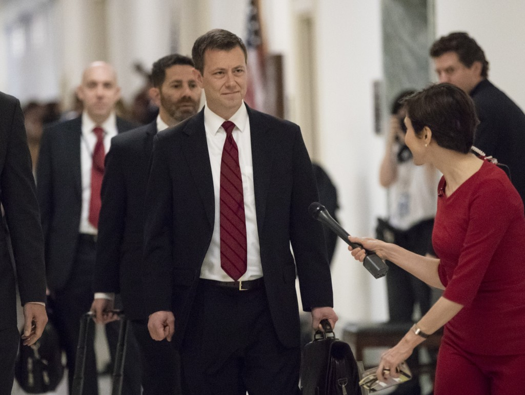 FILE - In this June 27, 2018, file photo, Peter Strzok, the FBI agent facing criticism following a series of anti-Trump text messages, walks to gives
