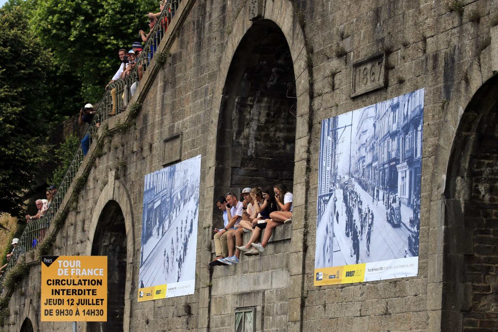 Spectators watch the start of the sixth stage of the Tour de France cycling race over 181 kilometers (112.5 miles) with start in Brest and finish in M