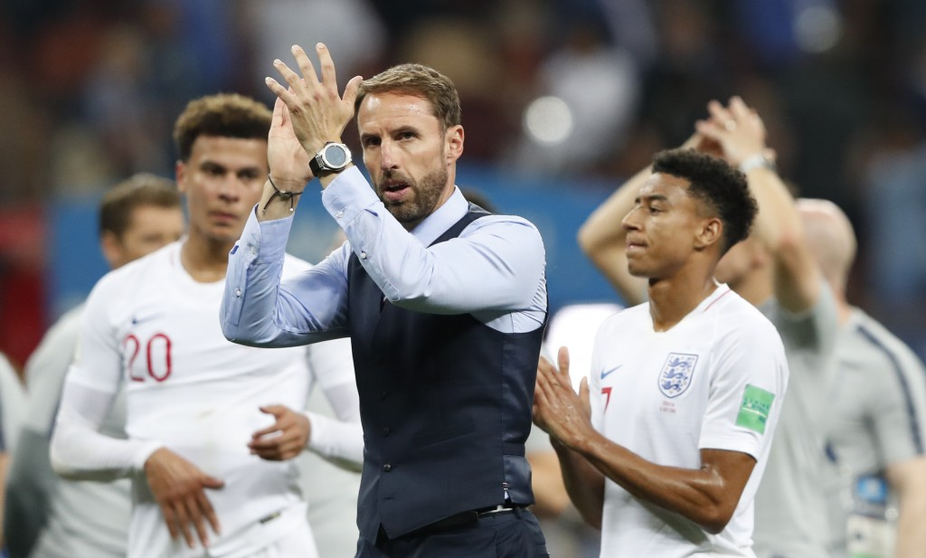 England head coach Gareth Southgate walks the field at the end of the semifinal match between Croatia and England at the 2018 soccer World Cup in the
