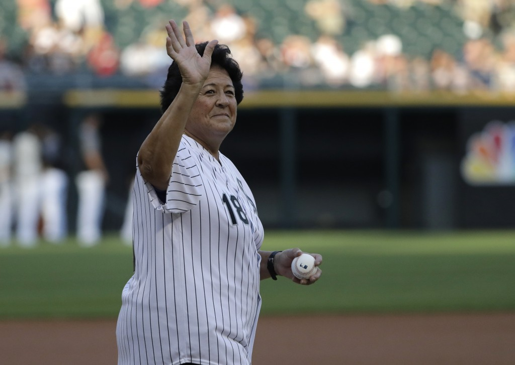 Former LPGA golfer Nancy Lopez waves before throwing a ceremonial first pitch before a baseball game between the St. Louis Cardinals and the Chicago W