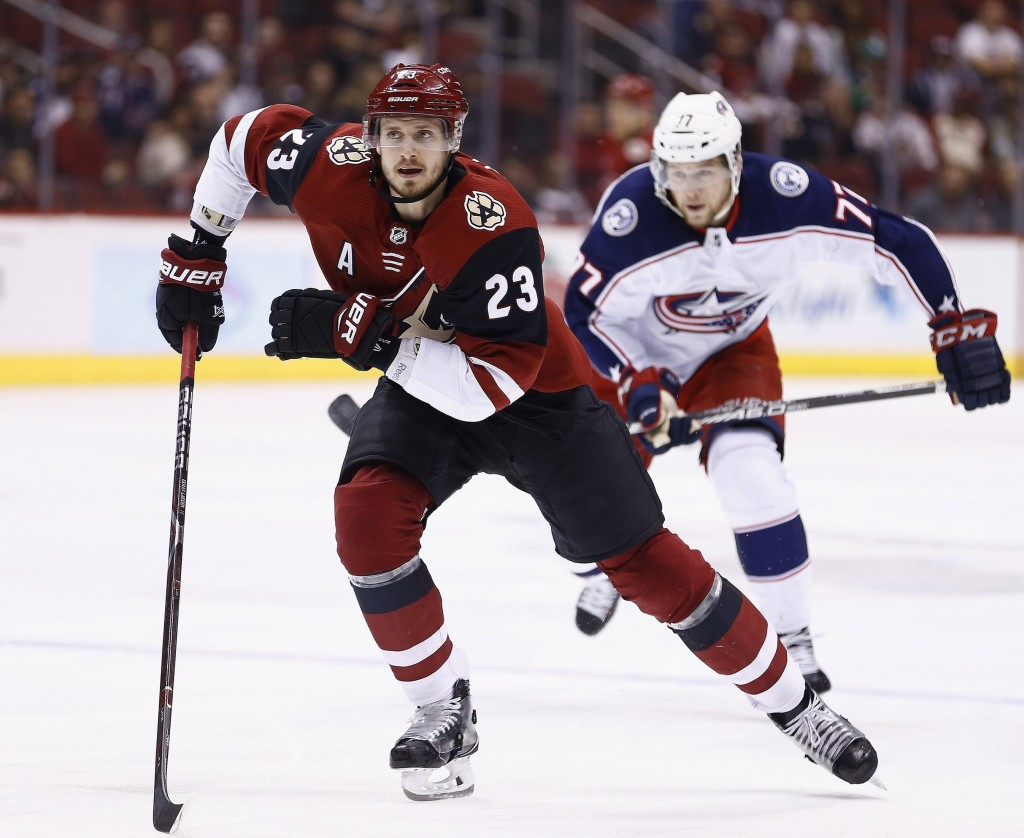 FILE - In this Jan. 25, 2018, file photo, Arizona Coyotes defenseman Oliver Ekman-Larsson (23) and Columbus Blue Jackets right wing Josh Anderson (77)