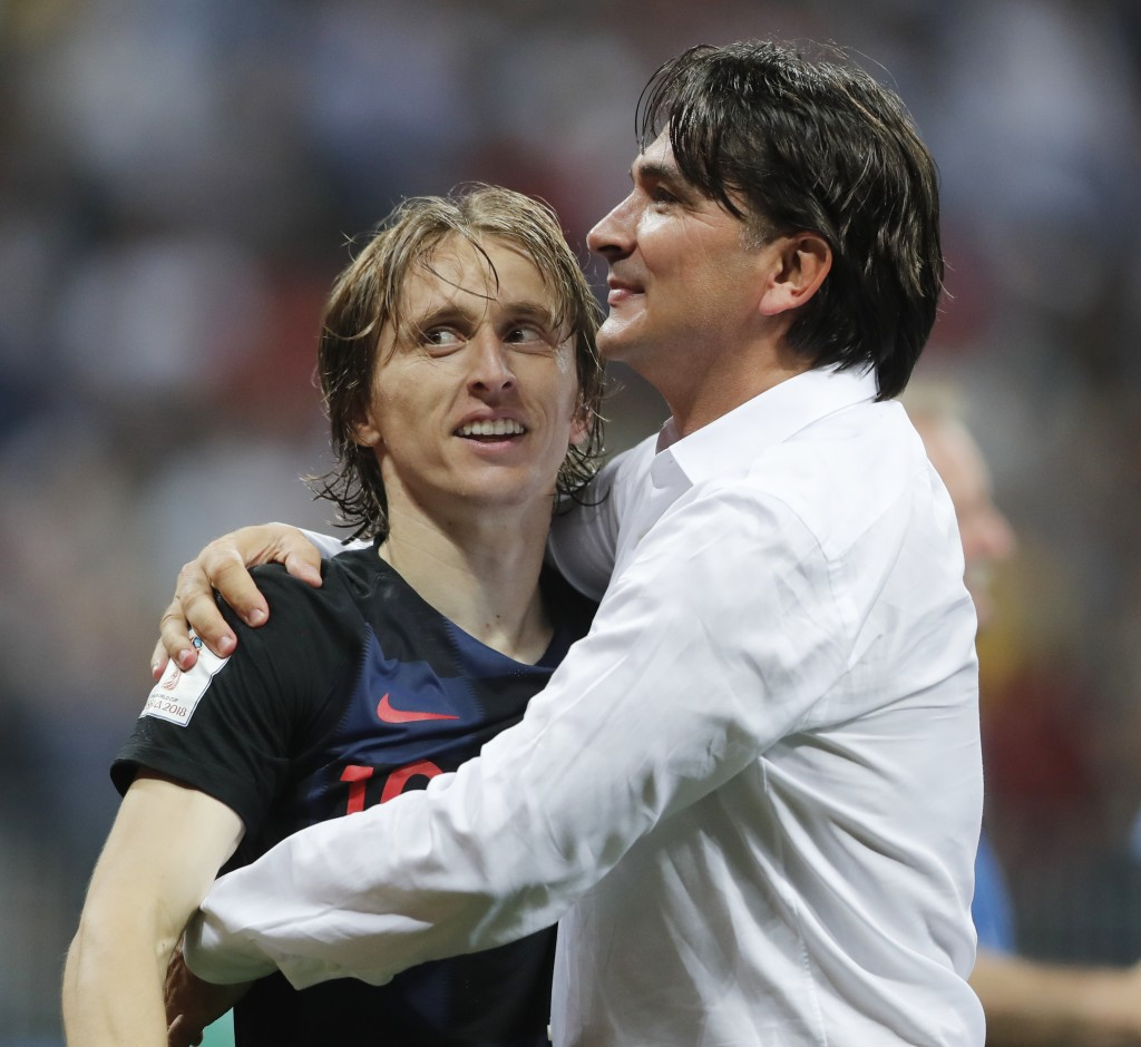 Croatia head coach Zlatko Dalic, right, celebrates with Luka Modric after his team advanced to the final during the semifinal match between Croatia an