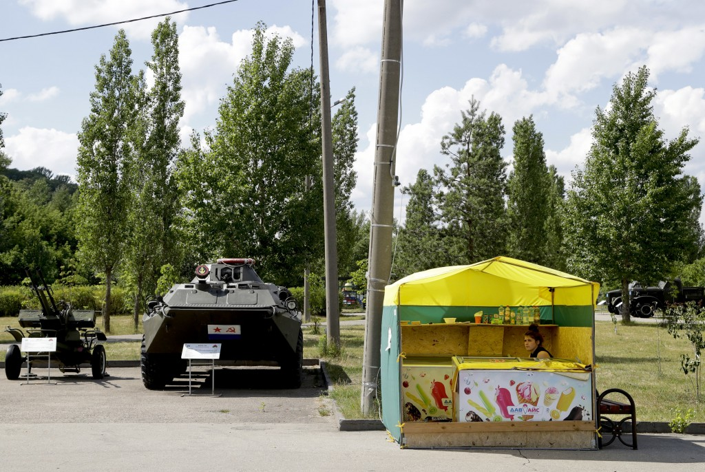 An ice cream seller attends her stand during the 2018 soccer World Cup in Nizhny Novgorod, Russia, Wednesday, July 4, 2018. (AP Photo/Petr David Josek