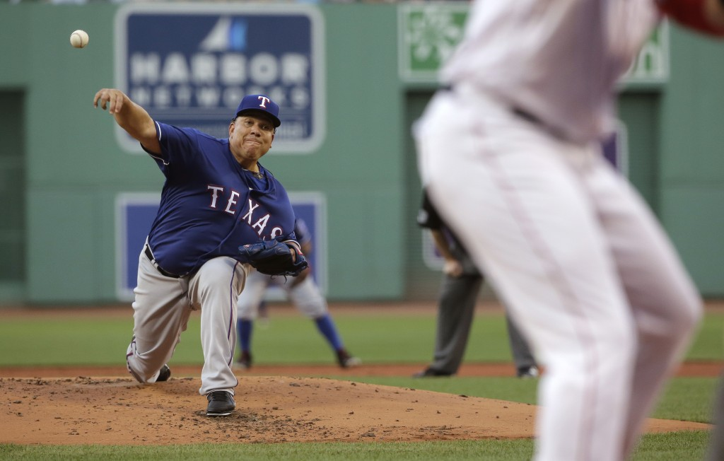 Texas Rangers starting pitcher Bartolo Colon delivers during the first inning of the team's baseball game against the Boston Red Sox, Wednesday, July