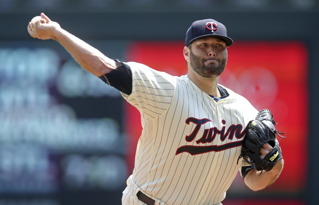 Minnesota Twins pitcher Lance Lynn throws against the Kansas City Royals in the first inning of a baseball game Wednesday, July 11, 2018, in Minneapol