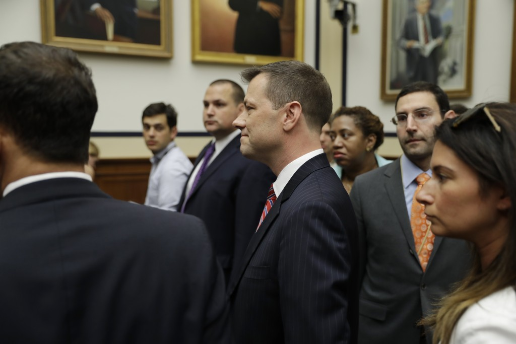 FBI Deputy Assistant Director Peter Strzok, center, arrives before the House Committees on the Judiciary and Oversight and Government Reform hearing o