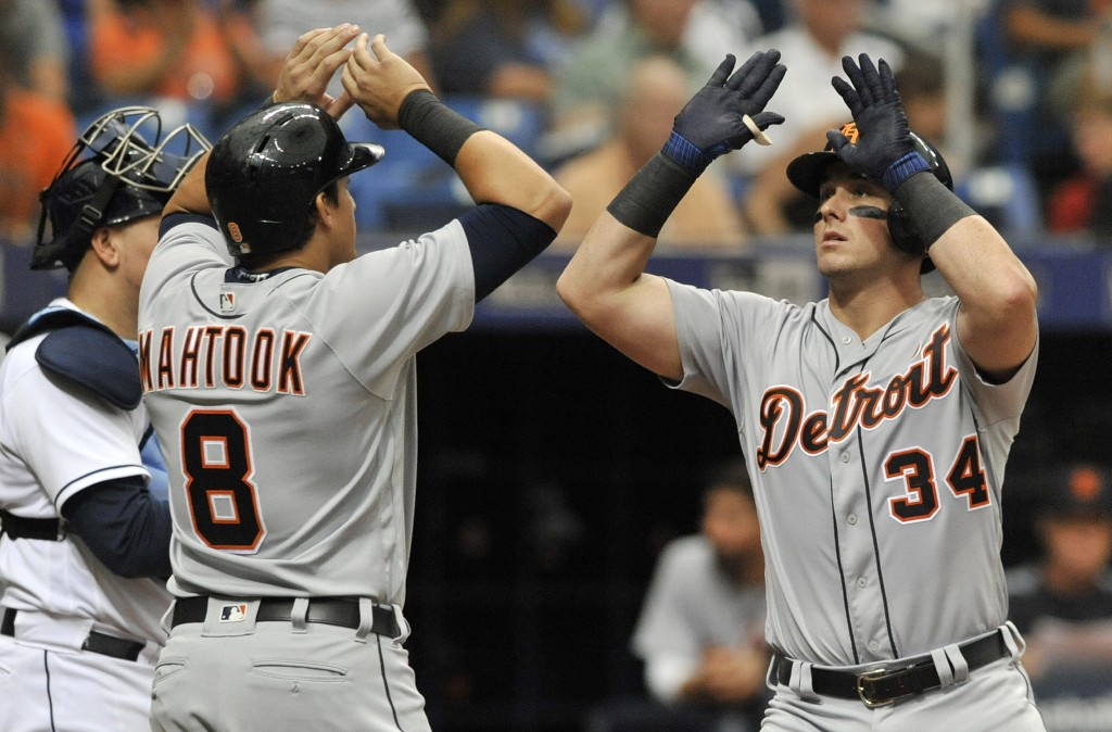 Detroit Tigers' Mikie Mahtook (8) congratulates James McCann (34) after McCann's two-run home run off Tampa Bay Rays reliever Matt Andriese during the