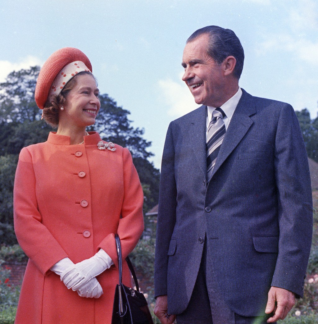 FILE  - In this 1970 file photo, Britain's Queen Elizabeth II, left, reacts with U.S. President Richard Nixon, at Chequers,  in Buckinghamshire, Engla