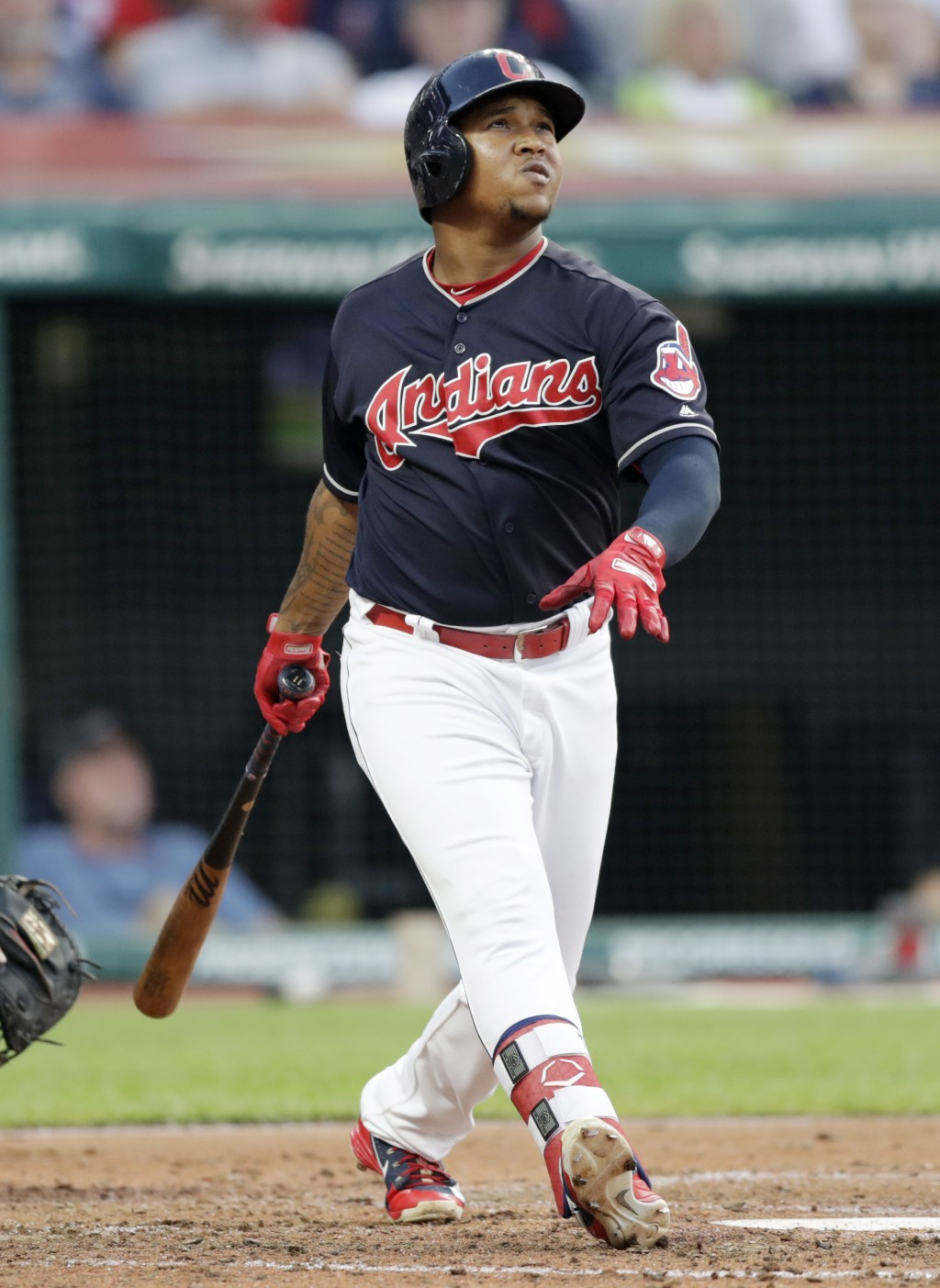 Cleveland Indians' Jose Ramirez watches his three-run home run off Cincinnati Reds relief pitcher Tanner Rainey during the third inning of a baseball