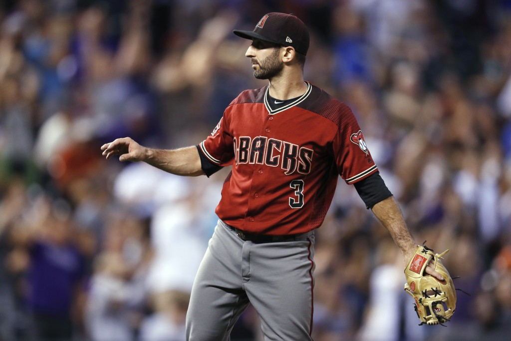 Arizona Diamondbacks infielder-turned-relief-pitcher Daniel Descalso calls for a new ball after giving up a three-run home run to Colorado Rockies' Ca